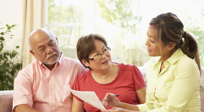 Seniors Lifestyle Magazine Senior Couple Talking To Financial Planner