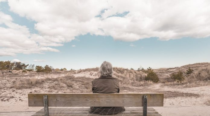 tension lady sitting on bench with scenery
