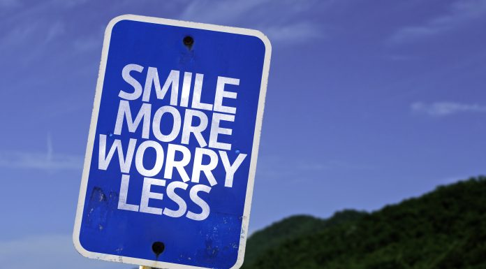 Smile More Worry Less sign scaled