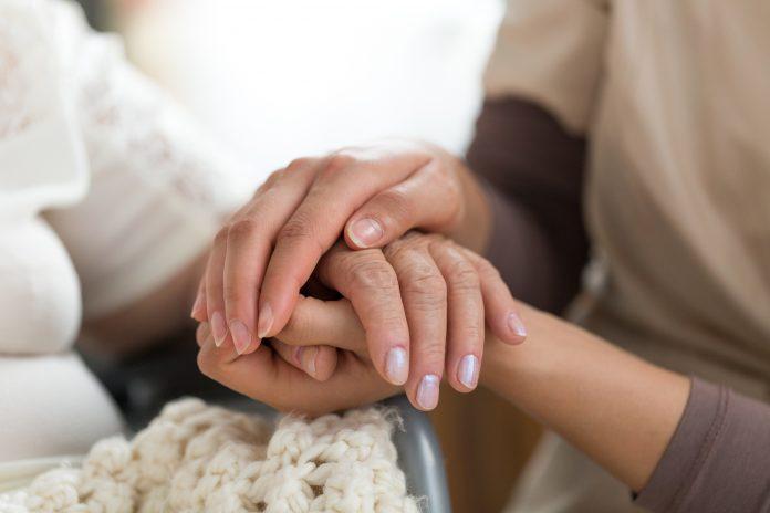 bigstock Caregiver Holding Senior Woman 203066512 scaled