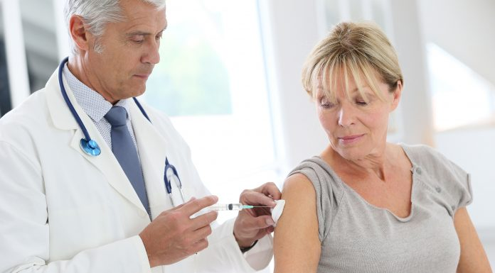 bigstock Doctor injecting flu vaccine t 102391031 scaled