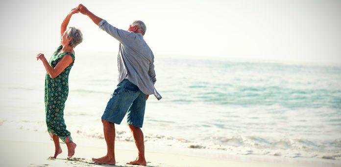 bigstock Senior couple dancing at beach 170495036 scaled
