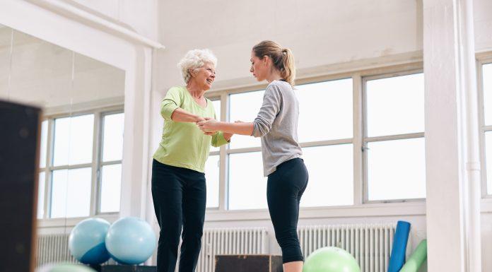 bigstock Trainer Helping Senior Woman O 81628928 scaled
