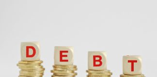 bigstock The Word Debt Written With Woo 242109769 scaled