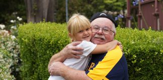 grandfather and girl are smiling